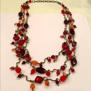Multi strand red glass faceted bead statement